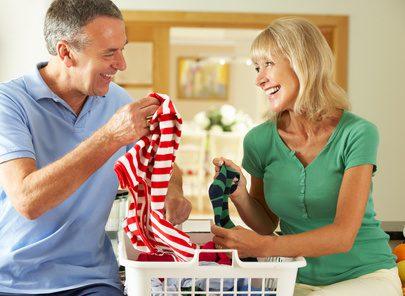Senior Couple Sorting Laundry Together