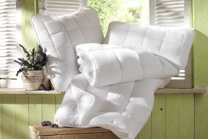 Bettdecken und Kissen reinigen
